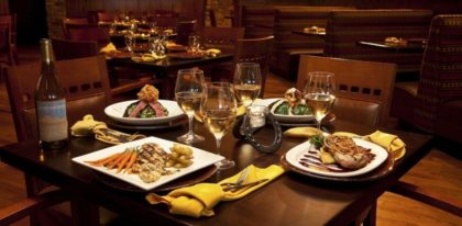 Deadwood grille restaurant with four meals setup on a table