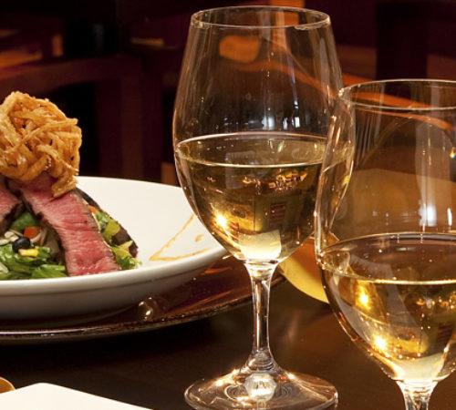 Steak Dinner with glasses of wine