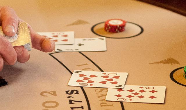 Man dealing a hand of blackjack
